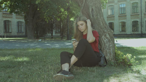 Charming girl browsing social networks on smart phone Footage