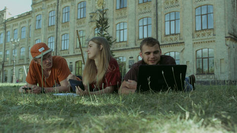 Students studying outside on campus on a sunny day Footage