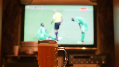 Television, TV watching (football, soccer match) with beer on table GIF