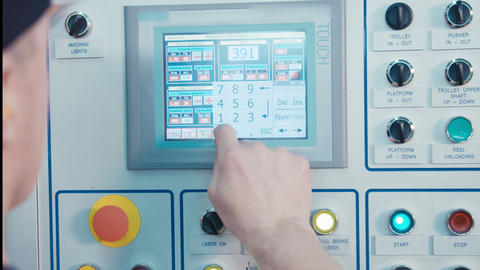 Worker pressing buttons on a machine control panel Footage