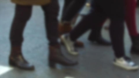 Detail of feet passing through a pedestrian crossing. Slow Motion Footage