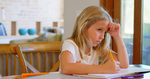 Girl doing her homework at home 4k Footage
