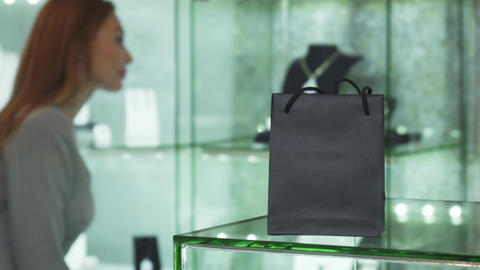 Selective focus on a shopping bag woman choosing jewelry on the background ライブ動画