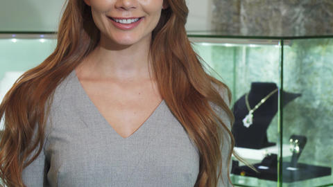 Cropped shot of a woman smiling holding shopping bag Footage