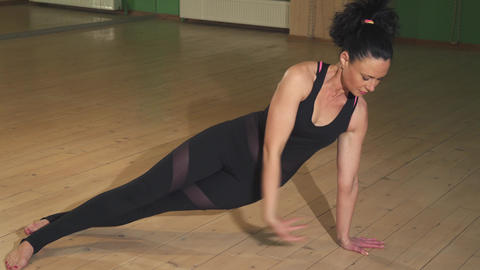 Beautiful woman doing yoga indoors stretching her body... Stock Video Footage