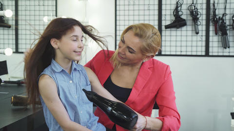 Beautiful woman drying hair of her daughter with a... Stock Video Footage