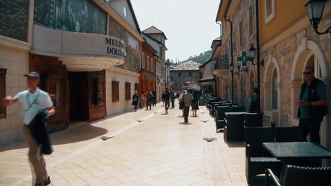 People Walking On The Street In Old City Footage