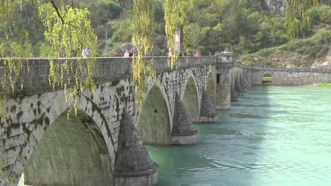 Old Pedestrian Stone Bridge across the River Footage