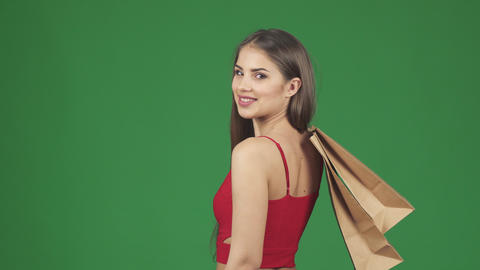 Happy beautiful woman smiling holding shopping bags showing thumbs up Footage