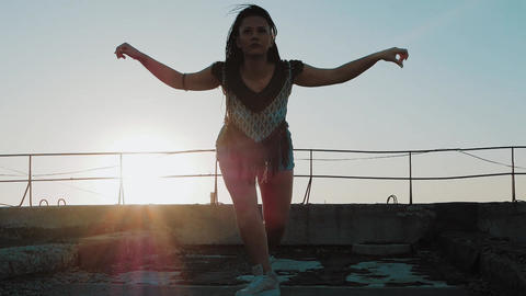 Dancing Female. silhouette happy mixed race woman dancing performance with long Footage
