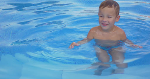 Smiling Boy in Swimming Pool Footage