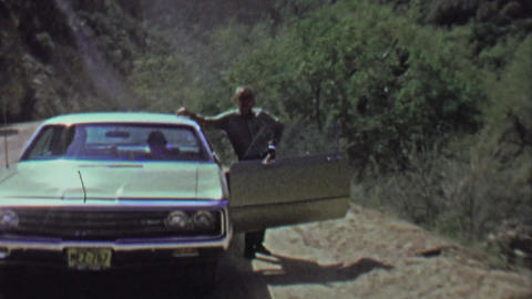 1961: Impatient dad family pulls over while family waits in car Footage