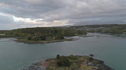 Bird and church Island with the Menai Bridge and the Straits at sunset Isle of ビデオ