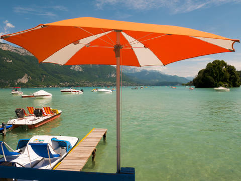 parasol and view on Lake Annecy, France Photo