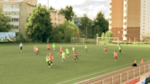 Defocused female junior football players on the field Footage