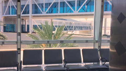 Airport terminal window view to outside. Empty aeroport interior GIF