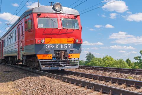 Suburban train travels by rail in Russia on a sunny day Fotografía