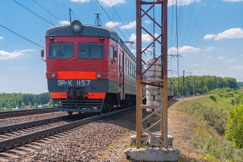 Suburban train travels by rail in Russia on a sunny day Photo