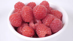 Bowl of raw raspberries Footage