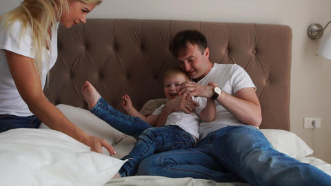 Happy family playing to pillows fight on bed at home Footage