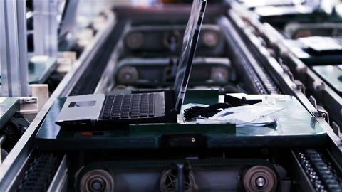 Assembly Line Workers Making Laptops Computers On A Factory Footage