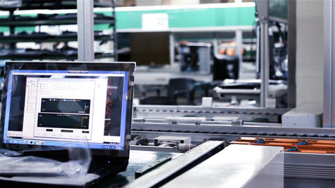 Assembly Line Workers Making Laptops Computers On A Factory Live Action