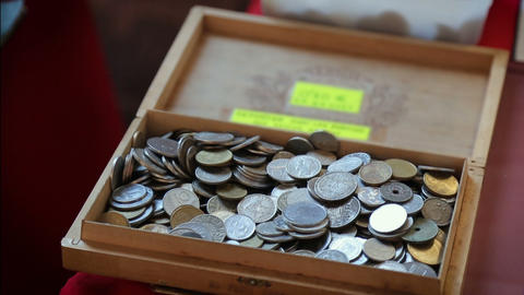 Big collection of retro coins piled up in old treasure box, numismatics, hobby Live Action