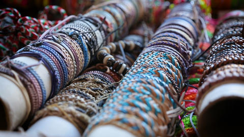 Variety of handmade friendship bracelets sold at local market, accessories Footage