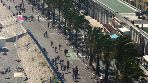 People walking southeastern coast of France, Mediterranean Sea, resort city life Live Action