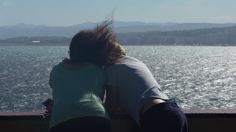 Sweet couple admiring Mediterranean seaside view together, romantic relationship Live Action