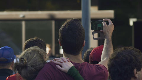 Crowd of devoted fans meeting favourite celebrity at airport, taking pictures Footage