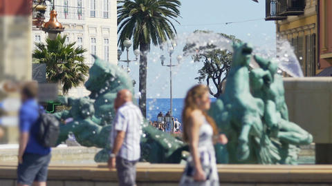 View of Mediterranean sea from famous square place massena with fountain, Nice Live Action