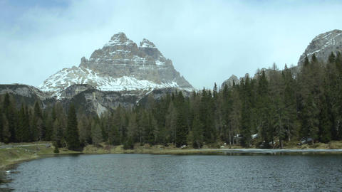 View of Three Peaks mountain across Misurina lake largest natural lake in region Footage