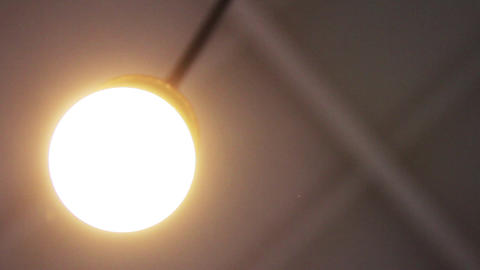 Ceiling Lamp Is Turned On And Then Turned Off. Close-Up Live Action