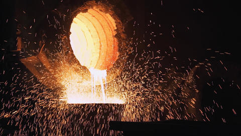 Foundry, Molten Metal Poured From Ladle For Casting Live Action
