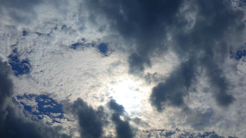 Sun and clouds moving on blue sky, time lapse Footage