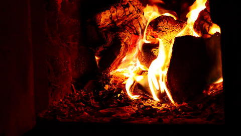 The firewood is burning in the fireplace. A beautiful glow. Strong fever Footage