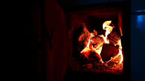 The wood in the fireplace is burnt. Beautiful flame Footage