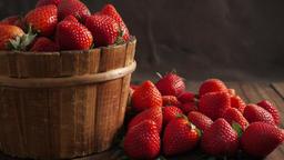 Ripe strawberries on wooden table ビデオ