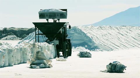 Bulldozer Working at Salt Flat. Salt Extraction. Salt Production. Lithium Live Action
