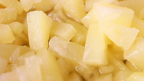 Pineapple slices rotating food texture closeup video footage. Studio lighting Live Action