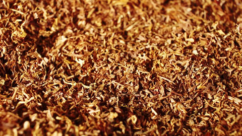 Tobacco grains rotating pattern macro texture background backdrop footage video Live Action