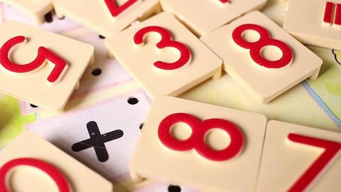Math education arithmetic number toy blocks rotating pattern macro texture Footage