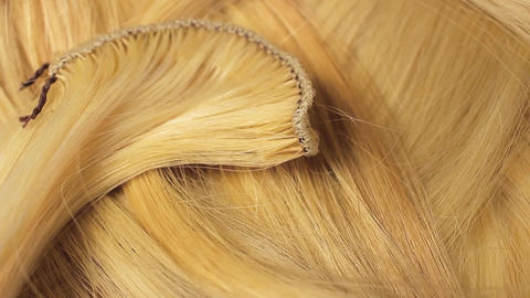 Hair extension cutted hair fibers blonde weft rotating pattern macro texture Live Action