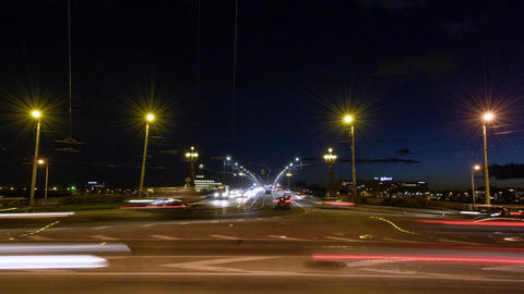Timelapse of a traffic going past the camera and crossing the bridge at night Footage