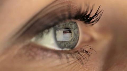 Woman girl eye macro looking monitor, surfing Internet social network facebook Footage