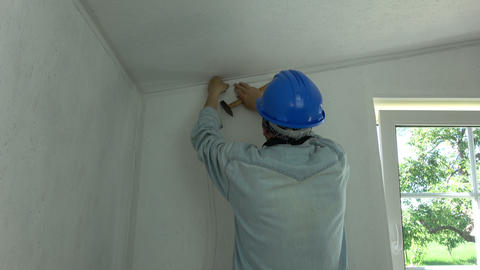 Worker with helmet in room fixing new electricity wire Footage