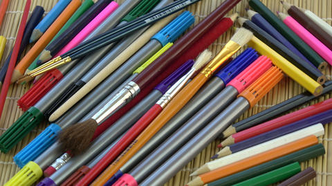Rotating colorful pencils, brushes and felt-tips background Footage