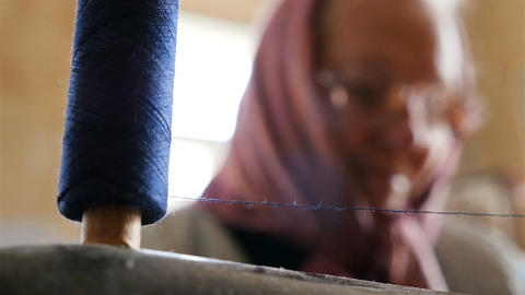 Close-up of a thread with threads on a sewing machine. Sewing of clothes. Slow Footage