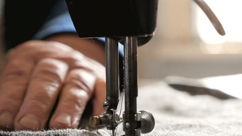 Close-up of needles and thread. Sewing machine. Sewing of clothes. Slow Motion Footage